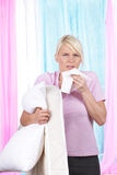Woman with handkerchief and cushion Stock Photography