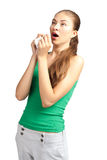 Woman with handkerchief sneezing Stock Image