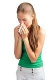 Woman with handkerchief sneezing Stock Photos