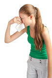 Woman with handkerchief sneezing Stock Images