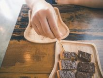 A woman handle stick into the chocolate on topping toast Stock Photo