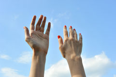 Woman hands  in the air Stock Images