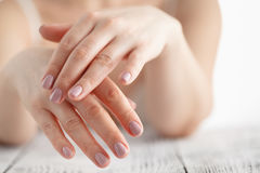 Woman hands applying moisturizing cream to her skin Stock Photos