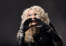 Woman hands around mouth, loud talking speaking, blonde curly ha Royalty Free Stock Photo