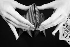 Woman hands assembling house of cards. Stock Photography