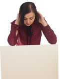 Woman hands back on canvas. Woman is hanging back on a canvas and looking down stock photography