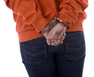 Woman from hands for backs in handcuffs Royalty Free Stock Photography