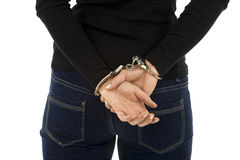 Woman from hands for backs in handcuffs Royalty Free Stock Image