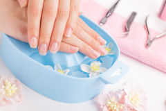 Woman hands in bath with water Stock Photo