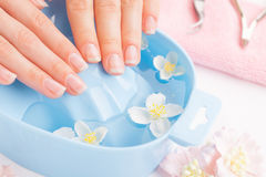 Woman hands in bath with water Royalty Free Stock Photography