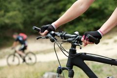 Woman hands on bicycle handle bars Stock Photography