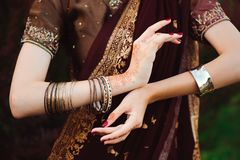 Woman Hands with black mehndi tattoo. Hands of Indian bride girl with black henna tattoos. Fashion. India.  stock photo