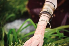 Woman Hands with black mehndi tattoo. Hands of Indian bride girl with black henna tattoos. Fashion. India. Woman Hands with black mehndi tattoo. Hands of Indian royalty free stock photography
