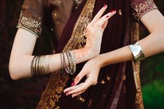 Woman Hands with black mehndi tattoo. Hands of Indian bride girl with black henna tattoos. Fashion. India stock photos