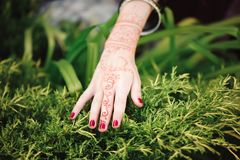 Woman Hands with black mehndi tattoo. Hands of Indian bride girl with black henna tattoos. Fashion. India stock photography