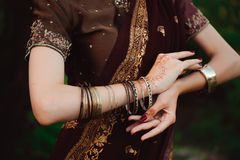 Woman Hands with black mehndi tattoo. Hands of Indian bride girl with black henna tattoos. Fashion. India royalty free stock photo