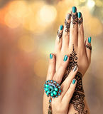 Woman Hands with black mehndi tattoo Royalty Free Stock Photography