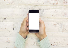 Woman hands with blank cell phone. Mock up royalty free stock photo