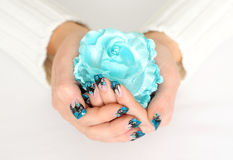 Woman hands with blue manicure. Nail royalty free stock photos