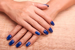 Woman hands with blue manicure and nail polish Royalty Free Stock Image