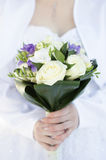 Woman hands and bouquet of flowers Royalty Free Stock Photo