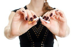 Woman hands breaking the cigarette. Royalty Free Stock Photography