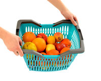 Woman hands carrying a full shopping basket. Stock Photos
