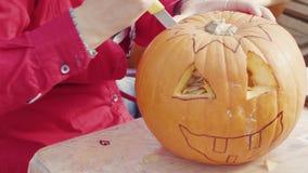 Woman hands carving pumpkin top for celebration Halloween