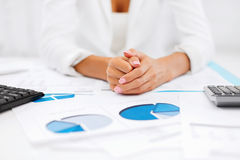 Woman hands with charts and papers Royalty Free Stock Photo