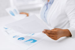 Woman hands with charts and papers Royalty Free Stock Images