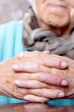 Woman with hands clasped. Elderly woman keeping her hands clasped, focus on hands Royalty Free Stock Photos