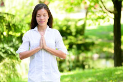 Woman With Hands Clasped Meditating In Park Royalty Free Stock Photos