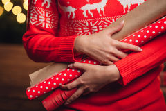 Woman hands closeup holding wrapping kraft paper for gifts Royalty Free Stock Photo