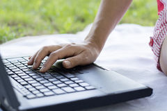 Woman hands closeup using laptop in park Royalty Free Stock Photos