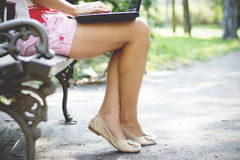 Woman hands closeup using laptop in park Stock Images