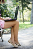 Woman hands closeup using laptop in park Stock Photo