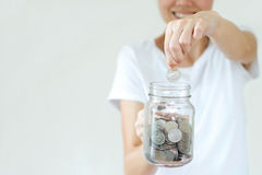 Woman hands with coins in glass jar Stock Photography