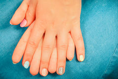 Woman hands with color nail polish. Manicure. Royalty Free Stock Photography