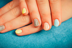 Woman hands with color nail polish. Manicure. Royalty Free Stock Image