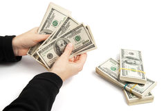 Woman hands count the dollars Stock Photos