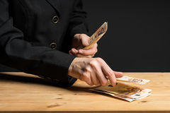 Woman hands counting money. Business woman holding fifty euro banknotes in hands. Royalty Free Stock Photos