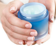 Woman hands with cream Royalty Free Stock Image