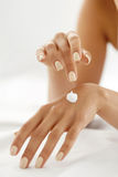 Woman Hands With Cream. Closeup Of Female Hands Applying Lotion Stock Photo