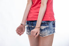 Woman with hands cuffed Stock Photography