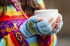 Woman hands with cup. Woman hands with fingerless gloves holding cup Stock Photography