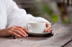 Woman hands with cup of morning tea Royalty Free Stock Photo