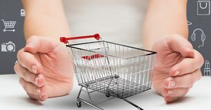 Woman hands cupped around shopping cart Stock Photos