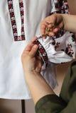 Woman hands  cut excess thread Stock Photos