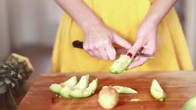 Woman hands cutting avocado stock video