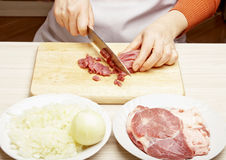 Woman hands cutting beef Royalty Free Stock Images